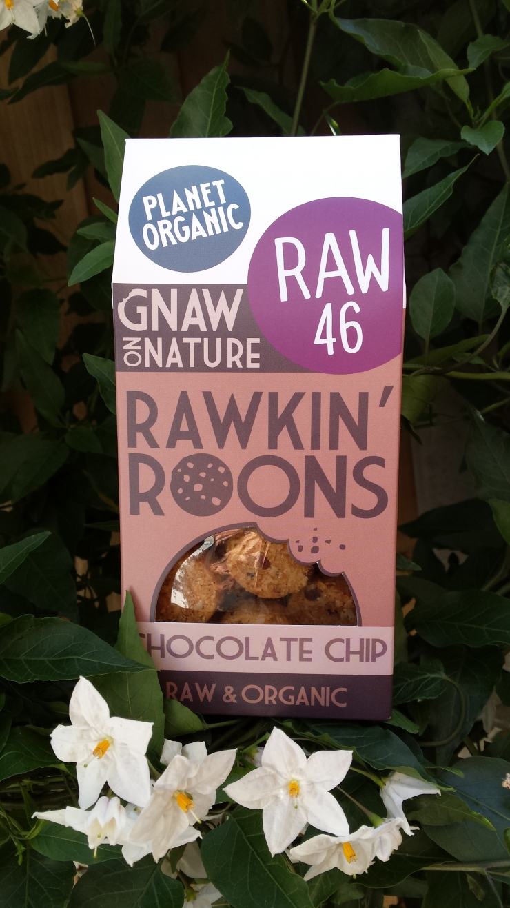 A packet of rawkin roons against some flowering honeysuckle.