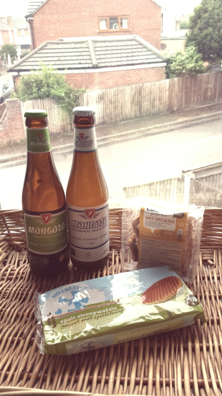 Two bottles of beer, packets of stroopwaffels and speculooos