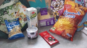 AProducts from LIdl photographed agsinst some shopping bags