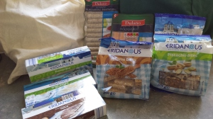 Products from Lidl's Greek range next to some shopping bags,