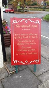 The Brook Inn street sign.