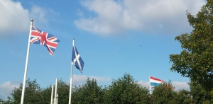 The flags of Scotland, The UK, and The Netherlands