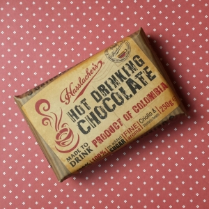 A wrapped bar of Hasslacher solid hot chocolate